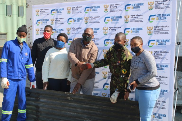 Gert Sibande TVET College hands over corrugated iron roof sheets to the needy